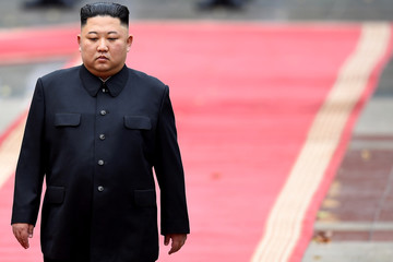 North Korea's leader Kim Jong Un attends a welcoming ceremony at the Presidential Palace in Hanoi