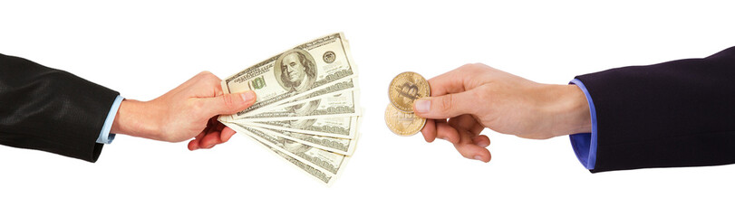 Golden Bitcoins on US dollars in the hands
