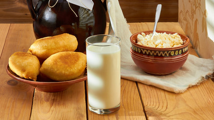 A delicious breakfast, pies with cottage cheese and cool milk - a reserve of energy for a day.