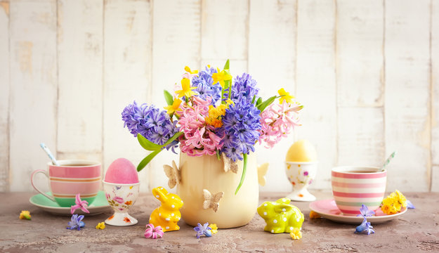 Easter breakfast table with flowers and  Easter decor