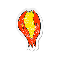 retro distressed sticker of a cartoon rocket ship flames