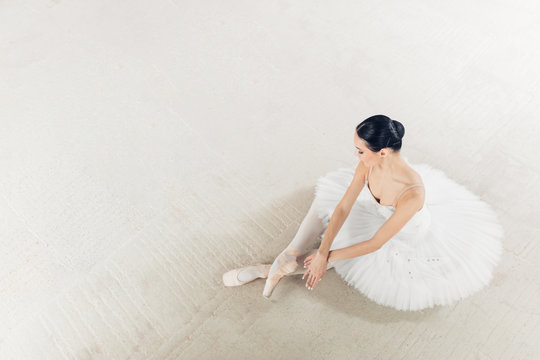 top view photo. talented ballerina has finished her wonderful performance, copy space. relaxation