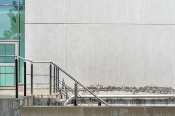 Iron railing with concrete building.