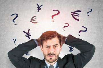 Confused businessman, currency signs