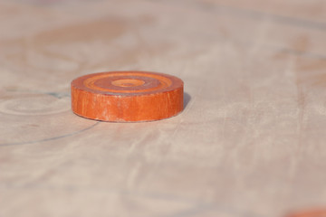 Queen disc of carom board