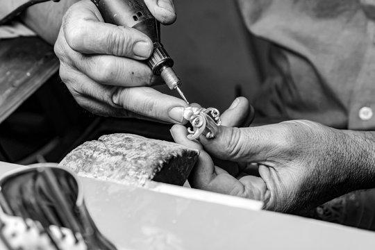 hands of jewelry technician