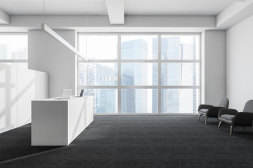 White office with reception desk and lounge