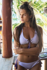 Young beautiful woman with sexy body wearing bikini
