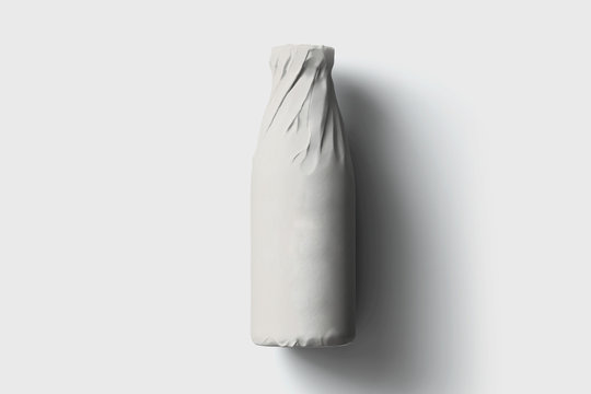 Bottle wrapped in white paper on white background.Mockup.High resolution photo.