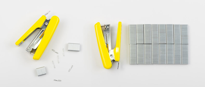 Yellow Office Stapler on Side with Staples Isolated