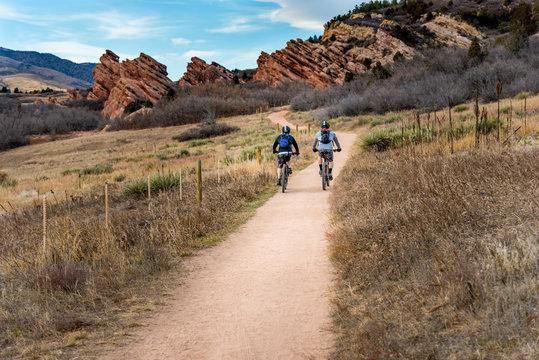 Two mountain bikers exercising on bike trail
