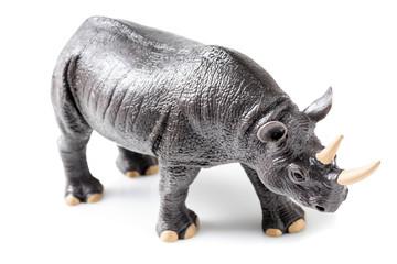 Rhino plastic figurine on white background