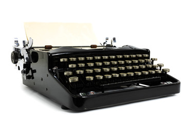 Old retro vintage black typewriter with paper and copy space on white background