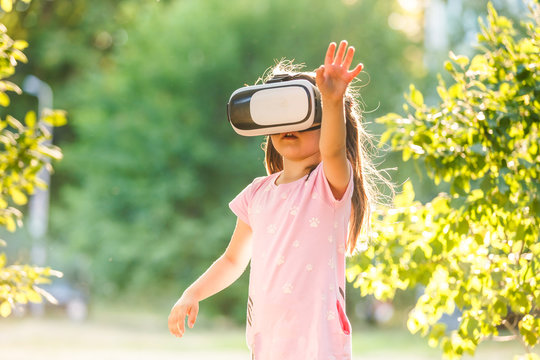 Digital technology virtual reality glasses 3d. Child plays in sertraline reality.