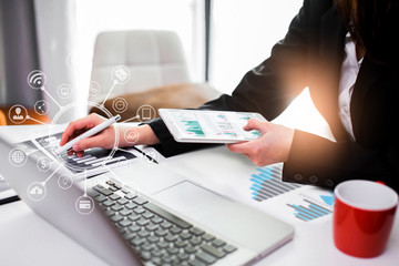 businesswoman working on laptop in an office