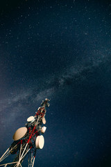Radio tower against starry sky