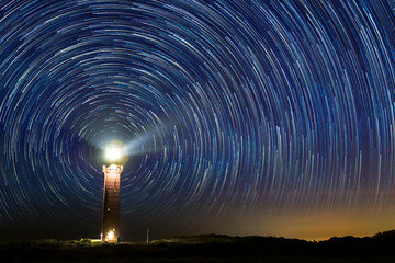 Foto op Aluminium Grandfailure Lighthouse at night with star trails at the center