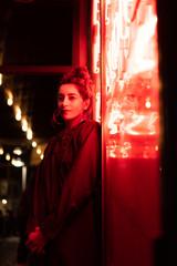 Attractive stylish lady near neon lights