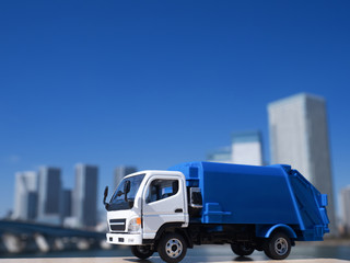 Fototapete - 清掃車とタワーマンション