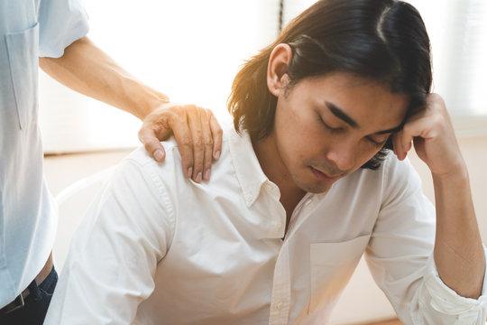 Person touching shoulder friend to encouragement.