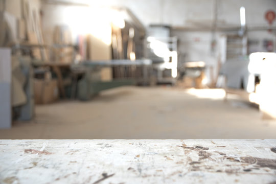 Blurred background of carpentry workshop. Copy space.