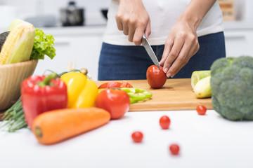 Close up woman preparing ingredient for salad.