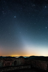The Zodiacal Light photographed from the Lindelbrunn ruin in the palatinate forest near Vorderweidenthal in Germany.