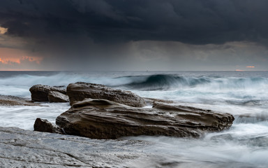 Moody and Rocky Seascape with Wave