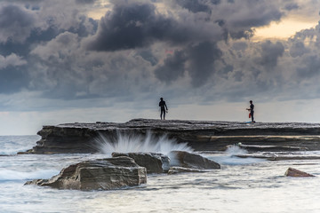 Rock Ledge, Spear Fishermen and Cloudy Seascape