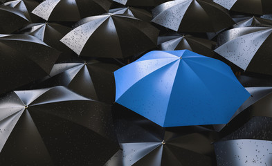 Red umbrella between black ones, standing out of the crowd concept image