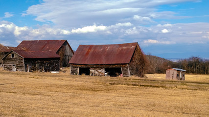 Abandoned Farm Buildings in Field