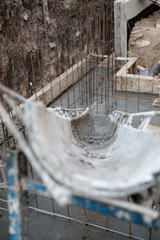construction of the building, concrete pouring of metal reinforcement cages of foundations