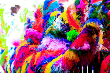 a colorful mexican ornament made with ostrich feathers in bright colors during mexican carnival in Tlaxcala