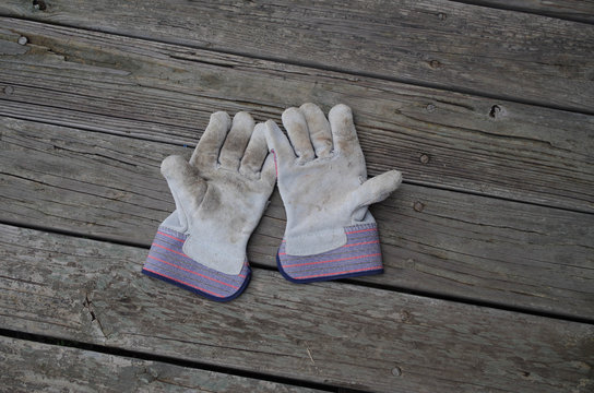 Inexpensive cotton and sueded leather work gloves - palms up showing use