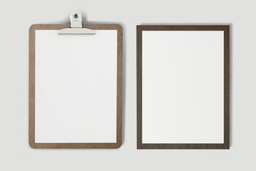 A wooden clipboard with a blank piece of paper (with clipping path) on soft gray background.