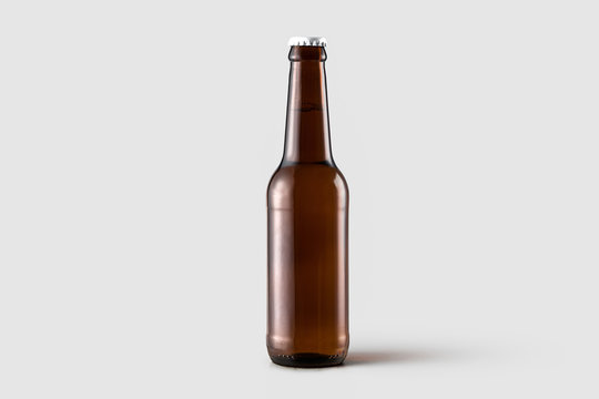 Bottle of beer Mock-up  isolated isolated on soft gray background.Can be used for your design and branding.