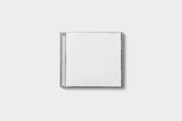 Closed compact plastic disc box case with white isolated blank for branding design. CD jewel mock-up on soft gray background.
