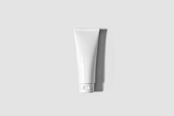Cosmetic White Plastic Tube Isolated on soft gray background. Mock Up.Сan be used for design and branding.High resolution photo.
