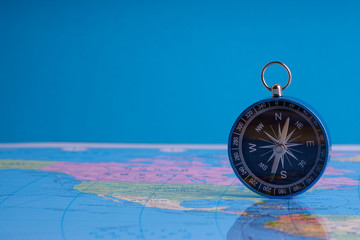 Kuala Lumpur, MALAYSIA FEBRUARY 27, 2019: Compass on world map background. Selective focus