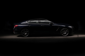 Four-door sport coupe. Silhouette of black sports car with headlights
