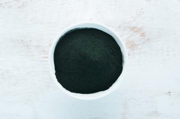 Spirulina powder. Superfood Top view. Free copy space.