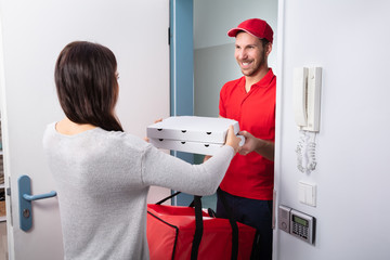 Man Delivering Pizza To Woman