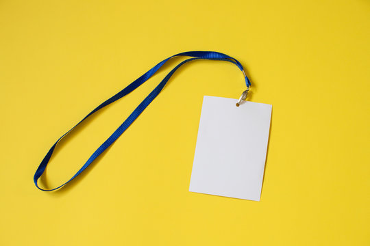 Empty ID card badge icon with blue belt, on yellow background. Space for text,  staff identity name tag template.