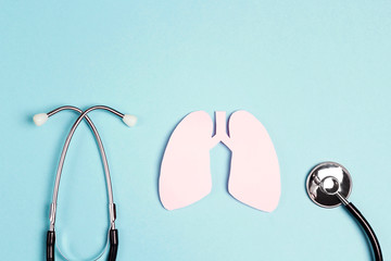 Lungs symbol with stethoscope on blue background. World Tuberculosis Day.