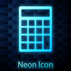 Glowing neon Calculator icon isolated on brick wall background. Accounting symbol. Business calculations mathematics education and finance. Vector Illustration