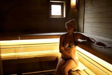 Fototapeta Woman in steam room
