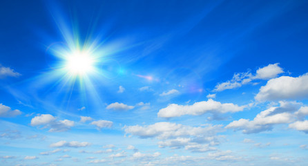 Sunny background with clouds