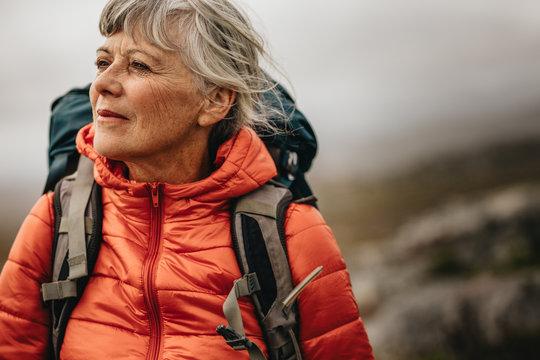 Senior woman on a hiking trip