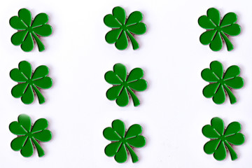 Background for St. Patrick's day. for design with clover. Clover isolated on white background. Irish symbols of the holiday. There is room for text.