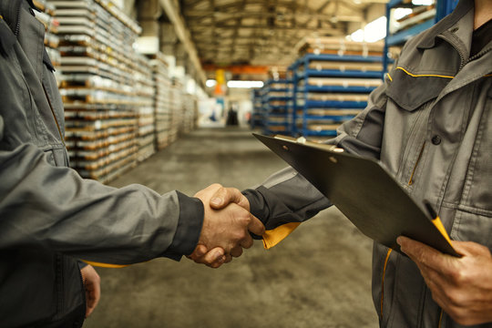 Engineer shaking hands at the industrial factory